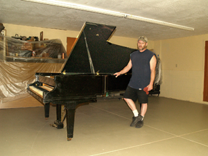 how to move a piano out of a basement